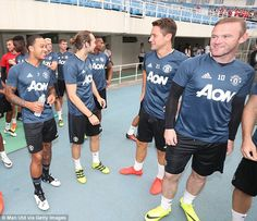 Wayne Rooney (far right) and his United team-mates managed to see the funny side of the bizarre situation