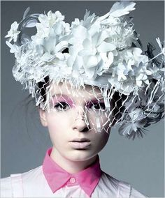 I love the amount of textures present because all the different items are stuck close together giving the piece quite a clustered look. Although there are a lot of shapes and patterns on the headpiece, the style of it seems quite simplistic due to the all white colouring.