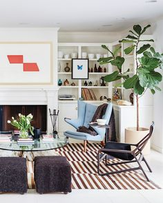 Striped rug, fiddle leaf fig, fireplace and built-in bookcases at Kelly Sawyer Patricof's Malibu Beach Cottage Interior Exterior, Interior Design, Built In Bookcase, Bookcases, Malibu Beaches, Decorating Blogs, Home And Living, Decoration, Room Inspiration