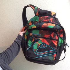Quicksilver Back Pack READ BEFORE YOU BUY First pocket is a lunch box type pocket can keep stuff cold! Although zipper is broken so if you know how to fix stuff like that this is perfect deal for you brand new just broke the zipper on accident. Quiksilver Bags Backpacks