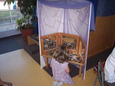 images of reggio inspired classrooms | reggio-inspired learning environments part 2 I love creating a little discovery space with a foam display board and small table.  The mirrors are a great provocation and the sheer fabric softens the space.