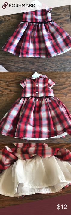 Party dress Baby Party dress. NWOT. Never worn. Black, white and red plaid design. Velvet trim and bow detail around waist. Layer of tulle underneath for poof. Comes with matching bloomers. Carter's Dresses