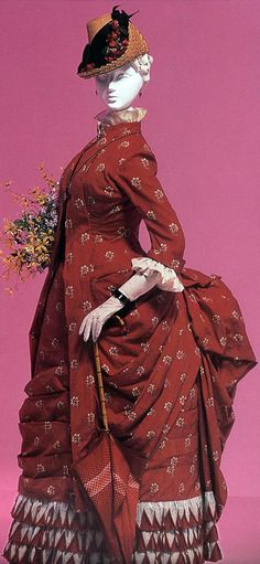 """""""Dolly Varden"""" dress ca. 1870. This style of dress was inspired by the 18th century polonaise. It was named for a character in Charles Dickens's novel Barnaby Rudge (1841). Photo probably scanned (by the Delsa Espirides blog) from Fashion: A History from the 18th Century to the 20th Century by the Kyoto Costume Institute."""