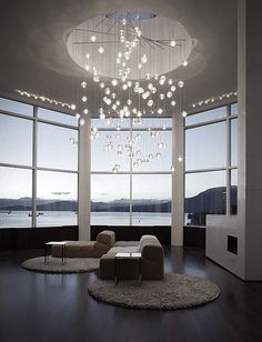 This large chandelier adds a nice touch and fills up the space in this big room with high ceilings.