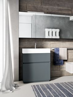 """Cubik bathroom furniture collection. Monoblock basin & cabinet solution, suitable for narrow spaces. This version features a white Aquatek basin and a glossy laquered cabinet, in the """"petrolio"""" (dark teal) color."""