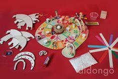 criar um jogo do ganso de raiz, com peças em materiais naturais e pintar o tabuleiro de madeira e acessorios respetivos