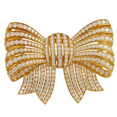 VAN CLEEF & ARPELS  Diamond Bow Pin | From a unique collection of vintage brooches at http://www.1stdibs.com/jewelry/brooches/brooches/