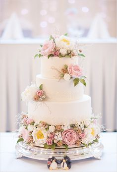 Stunning white and pink wedding cake with sugar flowers, including Peonies, David Austin Sugar Roses, berriers, buds, leaves and tendrils. Finished with an elegant lace trim for a vintage feel. Cake by Cake Avenue. Photographed by  3.2.1 Photography.