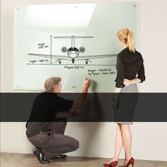 Clarus Glassboards.  Much more attractive than a white board and no ghosting.