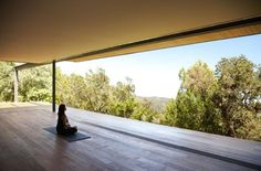 Nirvana in Sonoma: a spa pavilion for yoga, swimming, steam-bathing, and outdoor dining, designed by SF-based Aidlin Darling Design. The structure is cut into the landscape by two curved earthen walls and overlooks the rolling hills of Sonoma, providing a zen-like retreat from the main rammed-earth house.