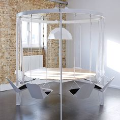 'We don't stop playing because we grow old, we grow old because we stop playing.' George Bernard Shaw Bring the playground into the boardroom or dining room with the Swing Table. Snap your staff or dinner guests out of the doldrums; meetings or dinners will become a fun and inspiring experience. Walnut from Forestry Stewardship Council managed forests and other controlled sources. Powder-coated mild steel. Walnut or Birch White Table top. 8 Person (L)247cm (W)247cm (H)220cm. Please allow…
