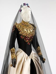 Wedding Dress by Christian Lacroix 1992. Dress made of silk net, lycra and silk satin, with gold leaf, foil, beads, paste gems and chenille embroidery. by James N. Salley