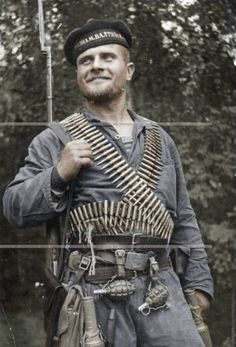 """Soviet partisan dressed in his navy uniform. It's interesting because during WW2 lots of Soviet sailors fought on the land (most probably due to Germans destroying their ships in the beginning of the war) and they proudly worn their hat and uniform everywhere. Most of Soviet Navy uniforms were black, so when Germans first saw the sailors charging them, they called them """"Black Death""""."""