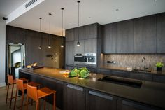 apartments, Amazing Large Kitchen Design In Black Design And Modern Cabinetry Also Sleek Islands With Nice Texture Backspalsh With Orange St...