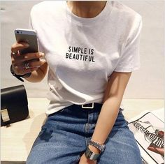SIMPLE IS BEAUTIFUL New Fashion Women Summer T shirt White Short Sleeve Cotton Letter Print Casual Top female T-shirts Get the latest womens fashion online new styles every day from dresses, and more . shop womens clothing now! Simple Shirts, Mom Shirts, T Shirts For Women, Clothes For Women, Short Shirts, Urban Apparel, Women's Summer Fashion, New Fashion, Womens Fashion