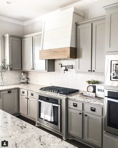 One of our FAVE DIY's ever is the faux oven hood we created simply by taking the cabinet doors off and creating a shell type hood/cover… Diy Kitchen Remodel, Kitchen Redo, New Kitchen, Kitchen Ideas, Kitchen Floor, Country Kitchen, Grey Cabinets, Kitchen Cabinets, Colored Cabinets