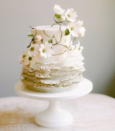 Love the rustic look of this wedding cake trimmed in dogwood blossoms from SouthernWeddings.com.