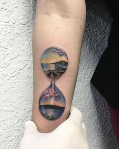 Landscape hourglass tattoo on the right inner forearm. Tattoo artist: Eva krbdk