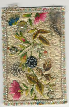 This beautiful postcard was a swap from Vanda, a member of Aceos/Postcards.  She used antique pearls, embroidery, feathers and all sorts of beautiful embellishments.