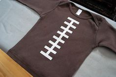 Too cute Super Bowl Craft Idea: How to make a DIY football t-shirt or football onesie.... So simple too! #party #football #diy LizaAmericasHost.com