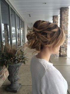 Loose wavy updo by Alyssa at Avante Salon and Spa, West Chester PA