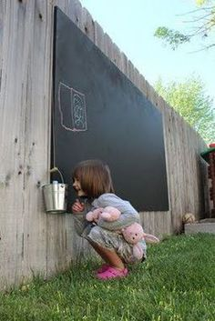 Backyard chalkboard! This is smart, less mess, and the rain would wash the chalk away. @ Do it Yourself Home Ideas