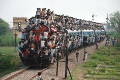 Indian rail. Can the driver see! or is every one just yelling instructions?