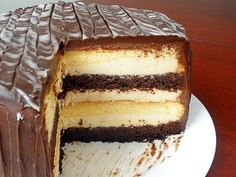 """""""Heaven and Hell"""" cake... Angel food cake and Devil's food cake, sandwiched together with a peanut butter mousse and then covered with chocolate ganache.     Wow."""