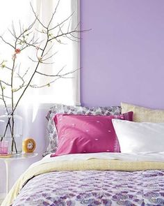 purple wall paint color, pink and yellow bedding