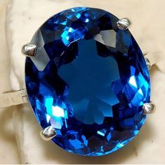 """20 Carat Sapphire in Sterling Silver Mounting 20 Carat Sapphire ring in Sterling silver solid mounting. Stamped .925. Gorgeous ring, the pictures don't do this justice! Stone dimensions are 2/3"""" long and 1/2"""" wide.  1st picture is stock photo. Jewelry Rings"""