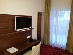 Alle Zimmer bieten Kabel-Tv und eine kleine Sitzecke.