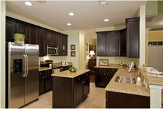 We love the dark wood cabinets paired with the light granite counter tops