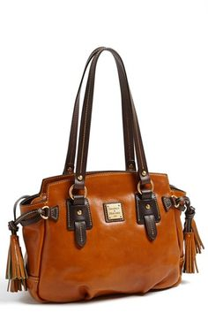 Nordstrom (Nov 2014) Dooney & Bourke 'Winged - Small' Leather Handbag $348.00	Free Shipping	 Item #989491  Free shipping and returns on Dooney & Bourke 'Winged - Small' Leather Handbag at Nordstrom.com. A smooth, hand-rubbed finish accentuates the timeless style of a structured leather handbag crafted with contrast trim and signature tassel details and fronted with a logo-etched plaque.