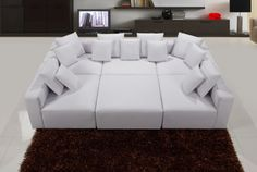 """Want a more modern and contemporary look for your living or entertainment room? This special edition of the Modular Miami 6 Pcs Sectional can be moved around to your own comfort or space. It is upholstered in faux leather with all decorate pillows included. Seating is firm with solid pattern. This modular sectional will definitely set the mood for a warmth and cozier feeling when you come home.  Dimension Armless Chair  37"""" x 25""""  Corner 37"""" x 25""""  Ottoman 37""""L x 16""""H  Measured from seat to…"""
