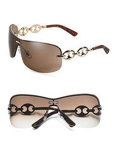 Gucci Rimless Metal Sunglasses..Got to have these also..lol