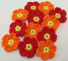 Crocheted Red Orange Flowers by FineThreads on Etsy, $4.20
