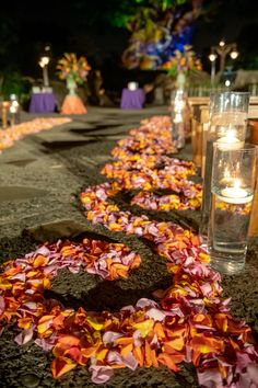 Aisle petal swirl and floating candles at Animal Kingdom Tree of Life ceremony