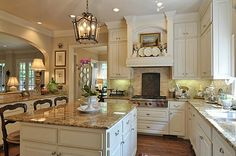 Lantern, opening between dining room, french chairs   traditional style hood  Trisha Troutz