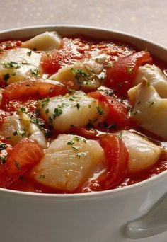 There are plenty of acids in tomatoes, and tomato-based sauces and stews can cause indigestion and discomfort to diners with sensitive stomachs. It's possible to reduce the acidity in the stew, or you can mask its taste for less-sensitive diners. Seafood Salad, Fish Salad, Fish Dishes, Seafood Dishes, How To Cook Cod, Cod Fish Fillet, Cuban Cuisine, Cuban Recipes, Nigel Slater