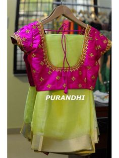 pastel green pure shimmer jute saree paired up with pink maggam work blouse