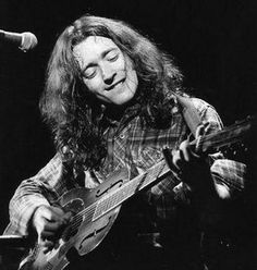 Rory Gallagher.  Man this guy could play guitar.  He was  a B.A. rock and roller.