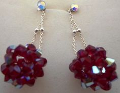 Silver #earrings with #Swarovski beads paint ball guns.
