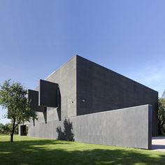 This house outside Warsaw by Polish architect Robert Konieczny transforms from a villa by day to a fortress by night.