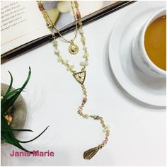 """✧Gold Tone Layering ✧ Necklace✧ DESCRIPTION:  Gold tone double layer """"Y"""" necklace with pastel chip stone beads accented with clear rhinestones. Approximately 34"""" in length. Janis Marie  Jewelry Necklaces"""