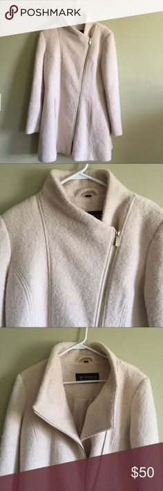 Guess Cream Wool Coat XL Beautiful and warm Guess coat. Size XL. Wool and poly. Fully lined. Used but in great condition. Some fuzzies throughout the coat but in great condition. Guess Jackets & Coats
