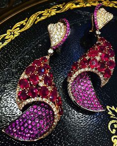 @imperialejoyeros. A true conversation piece of High-Jewelry. Ruby, Pink Sapphire, and Diamond earrings, set on rose gold.