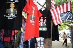 A shop sells T-shirts with depictions of US President Barack Obama at Kogelo market on July 13, 2015 in Kisumu, Kenya/AFP