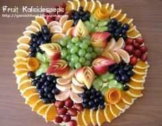Fruit Carving Display | with nectarine garnishes apple leave garnishes and orang roses ...
