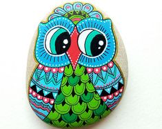 https://www.etsy.com/listing/464880679/hand-painted-stone-bird?ref=related-1