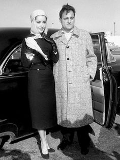 Elizabeth Taylor, in a classic and elegant suit, with her (3rd) husband Michael Todd in 1957.